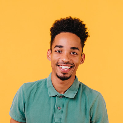 black guy looking like Desiigner smiling on yellow background
