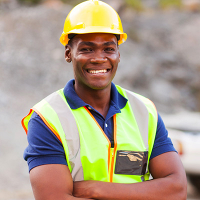 black worker guy in working gear on the field