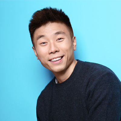 asian guy oin light blue background